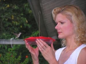 Rachelle feeding one of her female Hummingbirds.
