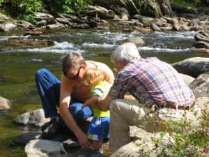 Wes, Colton and steve playing in the river.