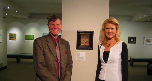 "Wes and Rachele by Wes's painting, ""Black-footed ferret"" at the opening of the Endangered Spieces Exhibit."