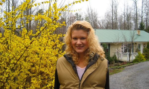 Me by our Forsythia in the front yard with our house in the background.