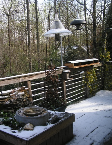 The back deck covered in an April snow.