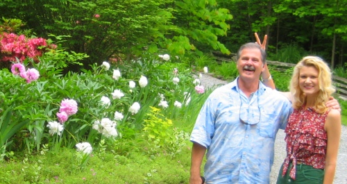 Stephen Left and I standing by my prized Peonies in the front yard.