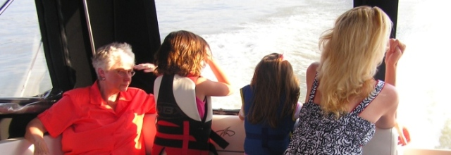 Jeanie, caroline, Alley and I, looking for something interesting on our boat ride.