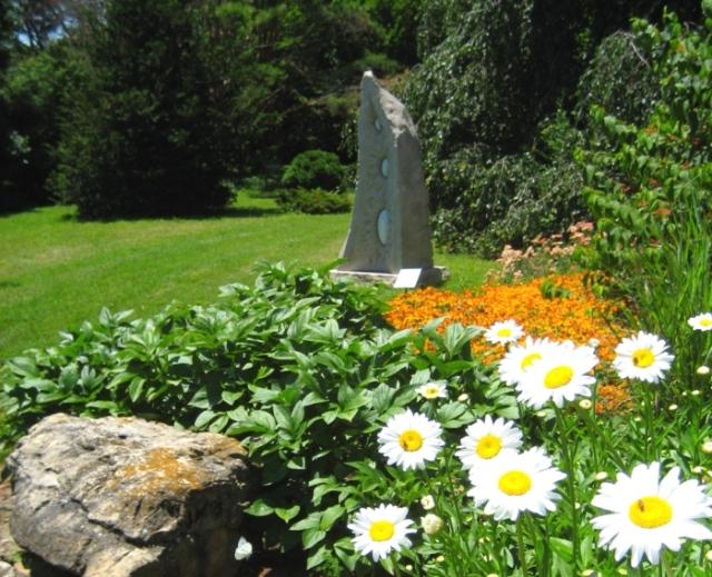 A beautiful egg sculpture amongst a sunlight section of the gardens.