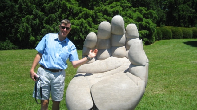 Wes shows off his miniature hand at Yew Dell Gardens.