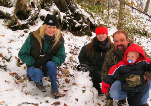 Me, Hayley, Marshall and Tyler posing with Mr. cool snowman.