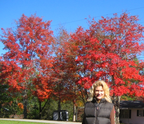 Myself with a few of the beauitufl red trees gracing our neighborhood.