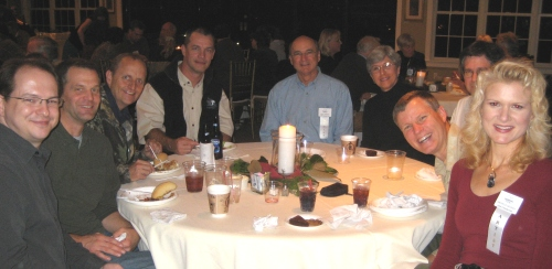 L to R: Dan, Ray Brown, Pat Pauley, Scot Storm, Bucky & Pat Bowles, Chris Chantland (hiding), Wes & Rachelle sharing laughs at the Waterfowl Festival Artists' party.