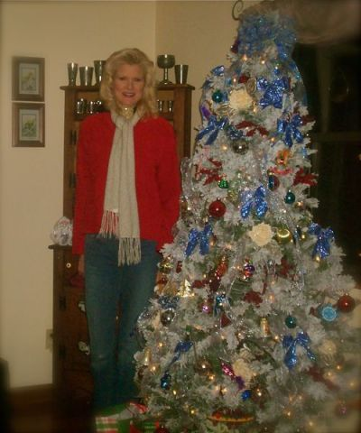 Rachelle Siegrist with a Christmas tree