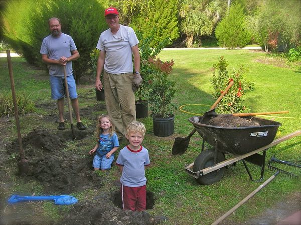 Marshall, Wes, Haydyn and Tyler planting bushes