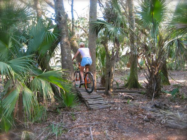 rachelle riding on the grassy island trail