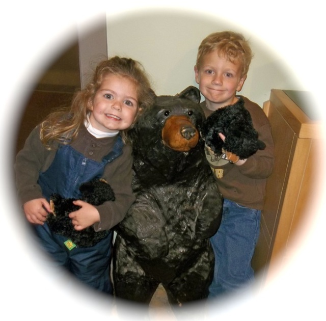 the kids with their black bears