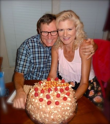 wes and rachelle siegrist with anniversary cake