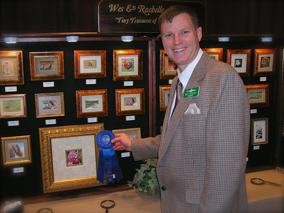 Wes Siegrist and his painting that received the Best Miniature Award at the 2004 NatureWorks Art Show & Sale