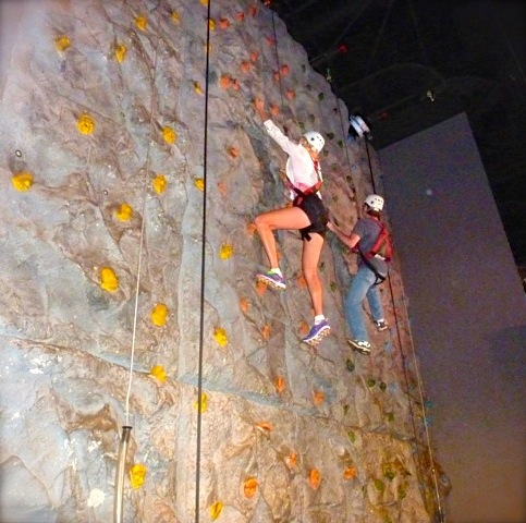 rachelle siegrist climbing rock wall at wonderworks
