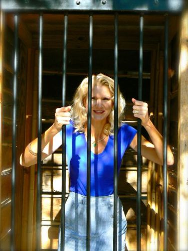 rachelle siegrist in cage at zoo