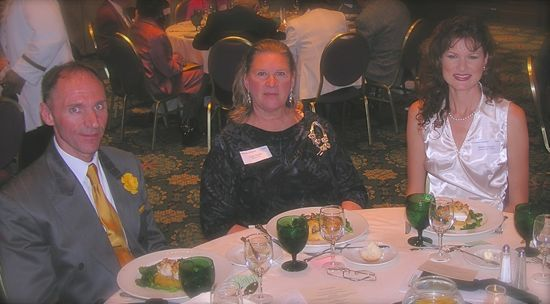 Rachelle with Michael Coe of England and Violet Temple of Canada during the 2004 World Federation of Miniaturists' Exhibition and Conference in Washington, D.C.