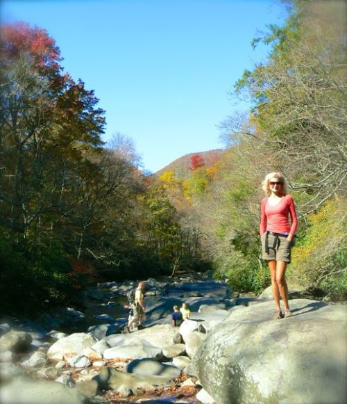 rachelle siegrist on rock on chimney tops trail