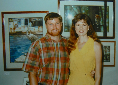 Wes and Rachelle Siegrist with his paintings in 1996