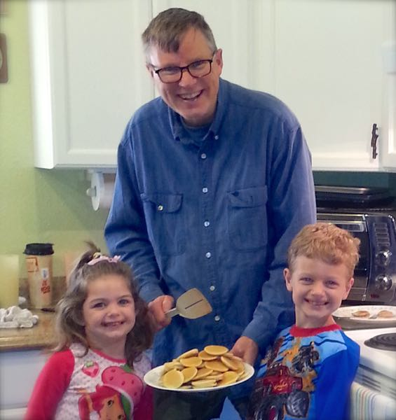 Uncle Wes making miniature pancakes with the kids