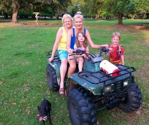 Rachelle Siegrist with family on four-wheeler