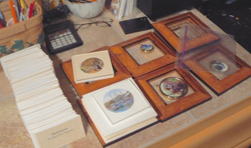 Hundreds of labels and paintings to be framed for the Siegrist Exhibition