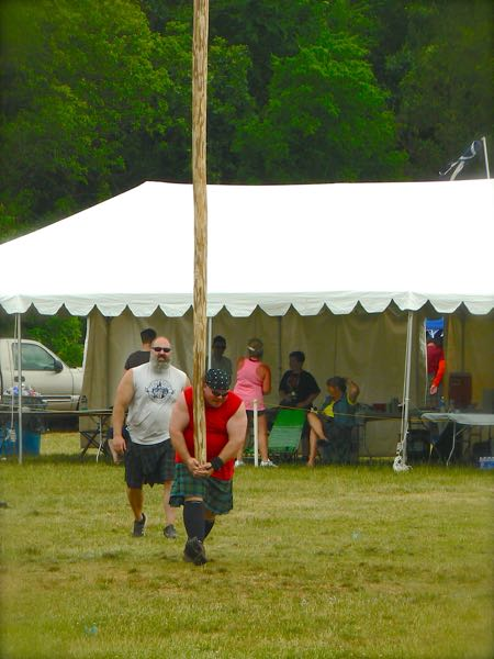 caber toss at smoky mountain scottish festival and games