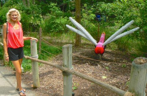 rachelle siegrist with sean kenney's dragin fly lego sculpture