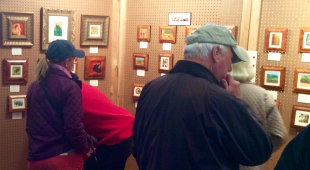 looking at the siegrist miniature paintings at the 45th annual waterfowl festival - 1