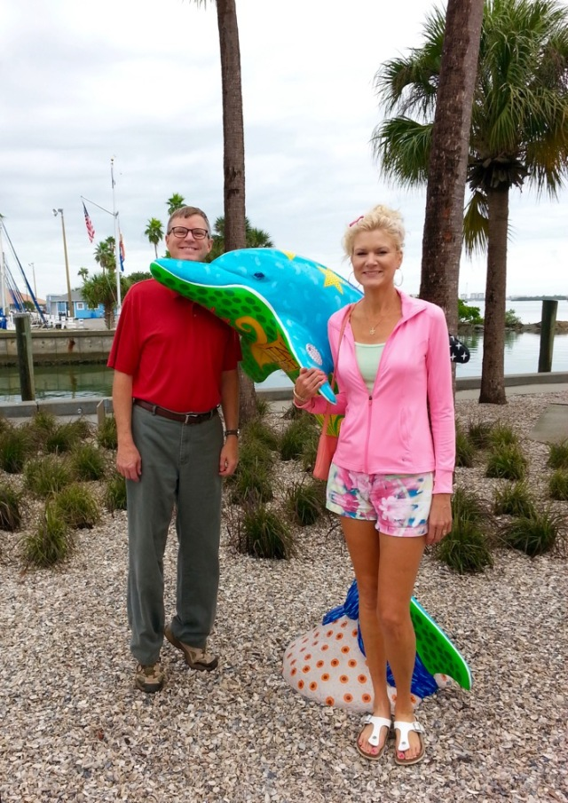 rachelle and wes siegrist with a dolphin