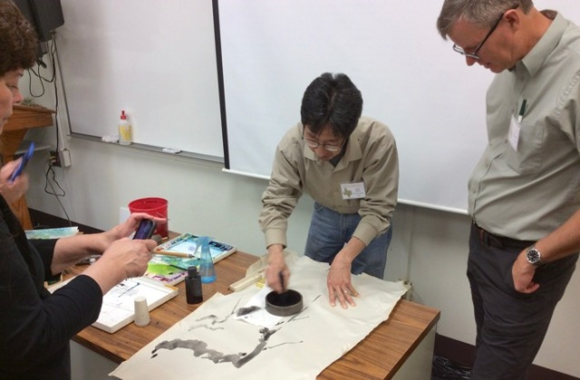 Dan Chen demonstrating chinese painting.jpg