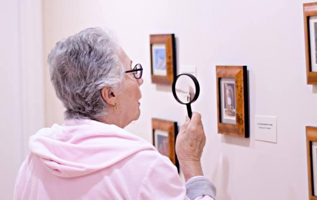 Lady looking at miniature at EM in Bonita Springs