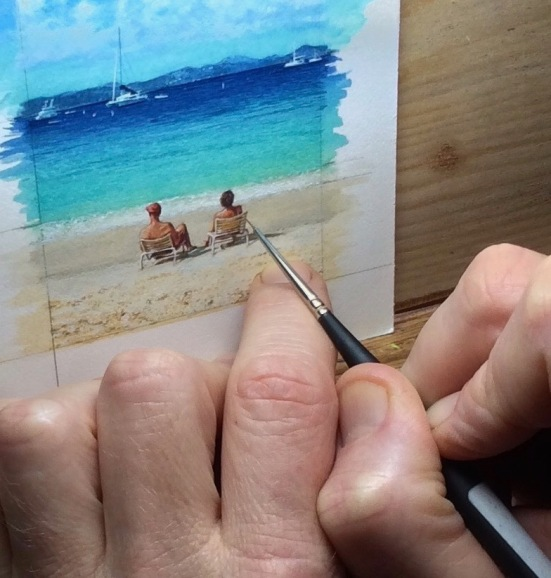 Wes Siegrist painting a miniature beach scene