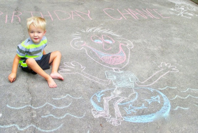 Chance with his 4th Bday drawings.jpg